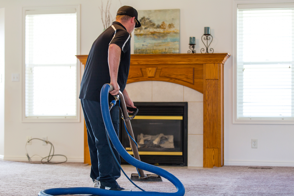Alpine Cleaning and Restoration Team Member Cleaning Carpet in a Home.