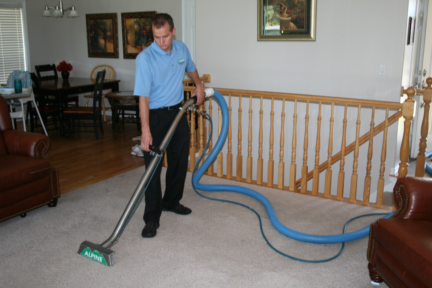 Alpine Cleaning and Restoration Team Member Cleaning Carpet